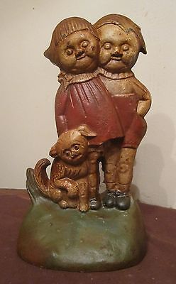 antique big hand painted heavy cast iron creepy figural twins child door stop