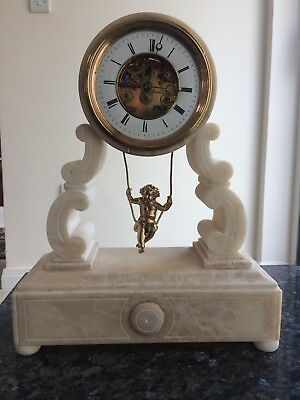 The large 19th century French mantel marble clock