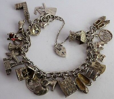 Beautiful vintage solid silver charm bracelet & 26 lovely charms.  76.3g