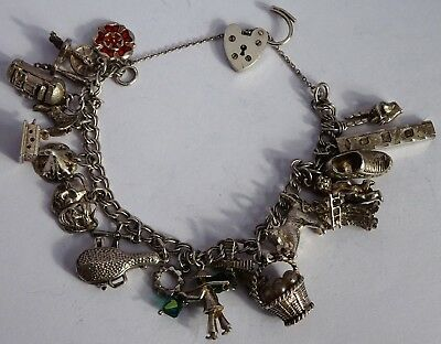 Amazing vintage solid silver charm bracelet & 18 silver charms. Rare,open,move