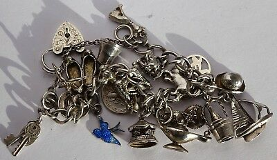 Beautiful vintage solid silver charm bracelet & 19 interesting  silver charms