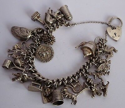 Gorgeous vintage solid silver charm bracelet & 23 interesting  silver charms