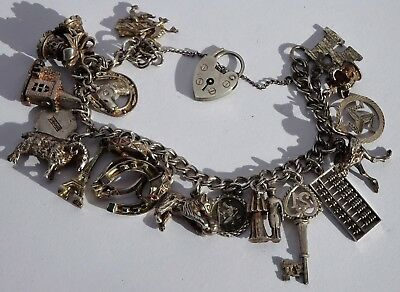 Gorgeous vintage solid silver charm bracelet & 18 interesting silver charms