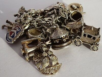Lovely vintage solid silver charm bracelet & 20 interesting silver charms
