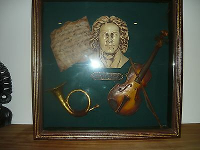 Beethoven bust and music instruments in the framed box