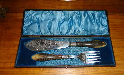 A Pair Of Late Victorian Cased Silver Plated Fish Servers,having Silver Collars