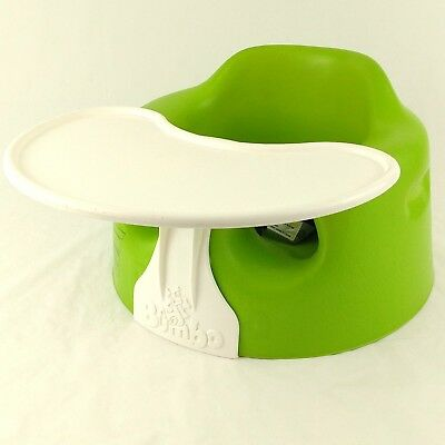 Green Bumbo infant baby seat with white tray and safety belt in VGC