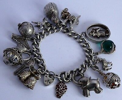 Amazing vintage solid silver charm bracelet & many large silver charms. 100.5g