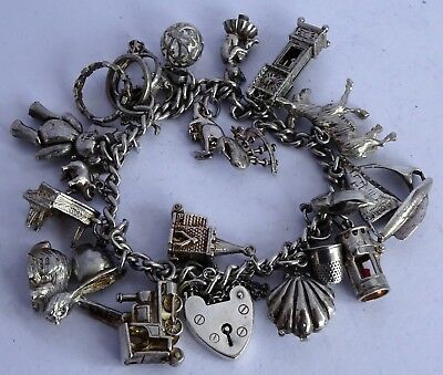 Fabulous vintage solid silver charm bracelet & 21 silver charms, open, move,rare