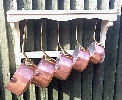 A set of 5 vintage Copper Pans with Brass Handles.