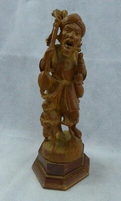 Early 20th century Indian Boxwood Figure of a Busker - Finely Carved Antique