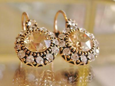 Stunning vintage inspired Champagne coloured Swarovski Elements earrings.