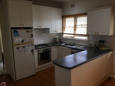 Secondhand - Kitchen Cabinets including oven cook top sink tap and range hood