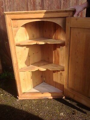 An antique  period wall corner cupboard in pine with original fittings