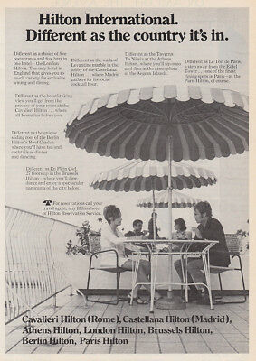1970 Hilton Hotels: Different as the Country, Umbrellas Vintage Print Ad