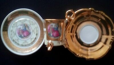 China cup and saucer. Gold and cream. Excellent condition