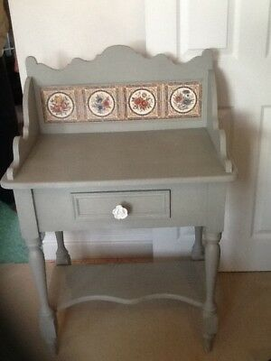 antique wash stand with tiled back