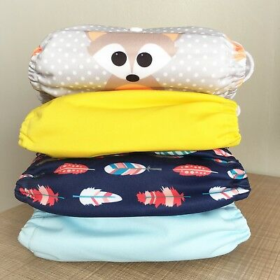 modern cloth nappies x 4 with inserts included