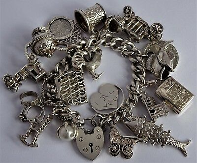 Amazing vintage solid silver charm bracelet & 18 large charms,move,open. 120.5g