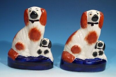 Pair of Handpainted Pottery Staffordshire Spaniels.