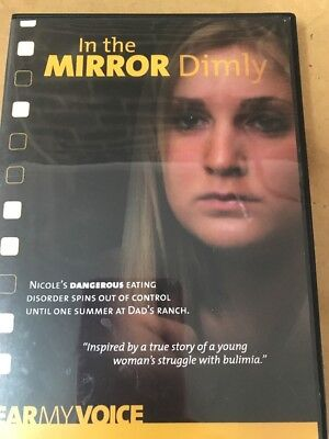 In The Mirror Dimly DVD