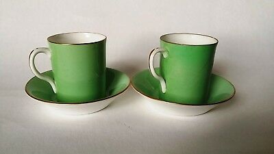 Pair of antique Royal Worcester coffee cups & saucers