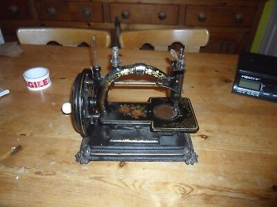 A very good Victorian Sewing Machine with fine decals