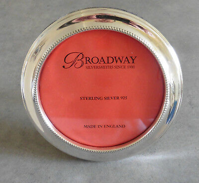 BROADWAY ENGLISH ROUND STERLING SILVER PHOTO FRAME. 5.5 inch diameter.