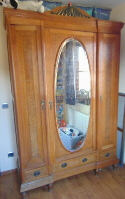 Big antique cabinet with an oval mirror