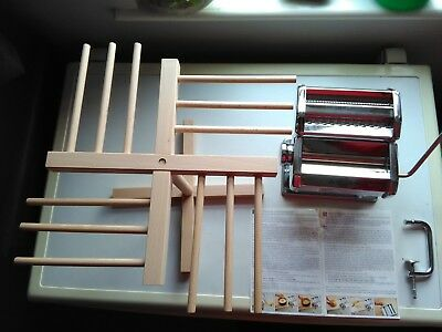 Atlas pasta making machine made by OMC Marcato in Italy and wooden pasta dryer