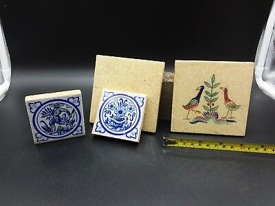 Collection of tiles. One is hand painted