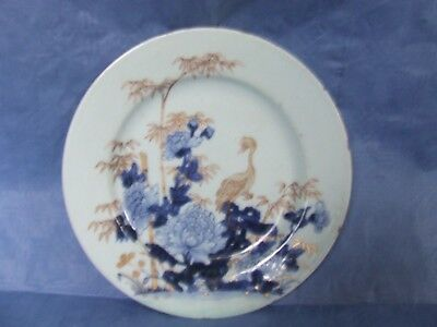Antique Chinese plate showing gold bird and bamboo amongst blue peonies