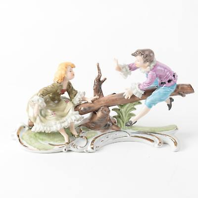A Lovely Vintage Amart Kpm Porcelain Figurine Of A Boy And Girl On A See Saw