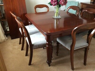 Victorian Mahogany 8 seater extending dining table and six chairs.