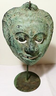 Antique Metal Mask on metal stand H29cm