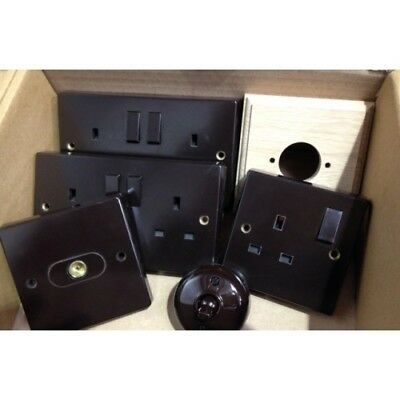 Brown Bakelite colection of light switches and sockets