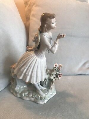 lladro figurines retired School Girl stops to smell flowers