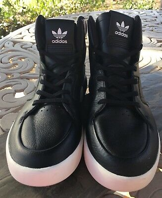 Adidas Black/White  Leather Tubular Womens High tops New And unworn Sz 5 1/2.