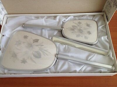1970's vintage brush, comb & mirror set. Original condition. Made in England.