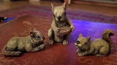 squirrel family of 3 carved miniature figurines
