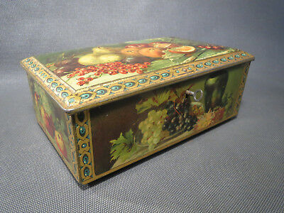 Antique pretty box iron to cakes or chocolates pattern still life with key