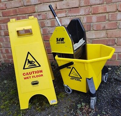 Large Janitor Bucket on wheels with caution slip sign