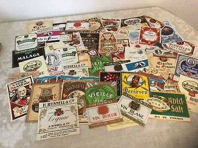 Large lot of hundreds of unused liquor, cosmetic and seed packet labels.