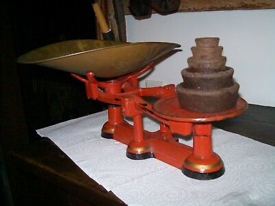 antique cast iron counter balance scale with waightsand brass scoop