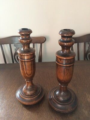 Pair of oak Arts and Crafts candle sticks