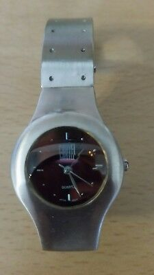 Watch Carvel Pink Translucent Ladies Fashion . Stainless steel strap.