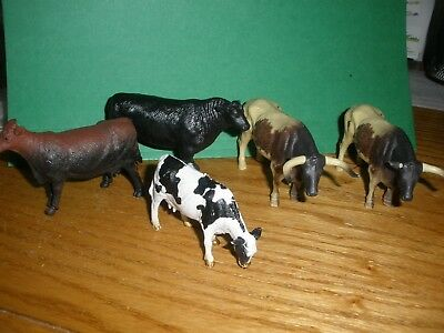 5 plastic toy cattle/steer