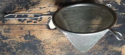 Old conical metal sieve