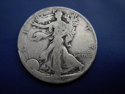 Nice better date 1938 Walking Liberty half in VG condition. #1