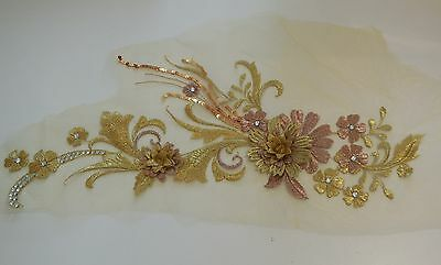 A large piece of gold & rose champagne beaded floral lace applique lace motif
